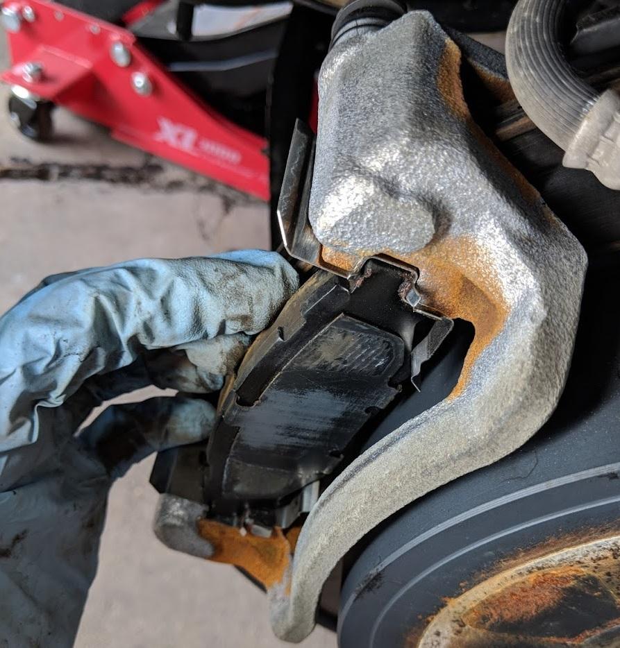 Unpainted brake calipers w/ corrosion