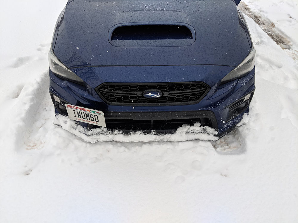 Plowing snow with the front lip