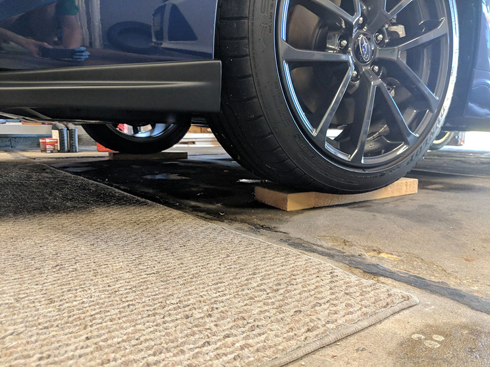 Jacking up the front of the WRX - ramps come in handy for clearance