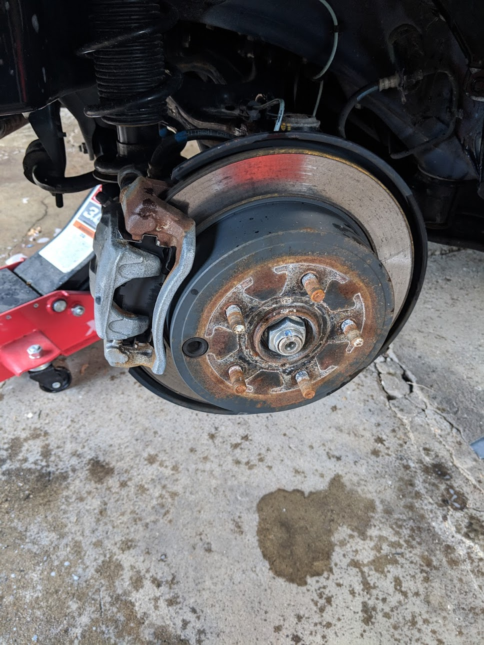 The stock, rusted WRX calipers