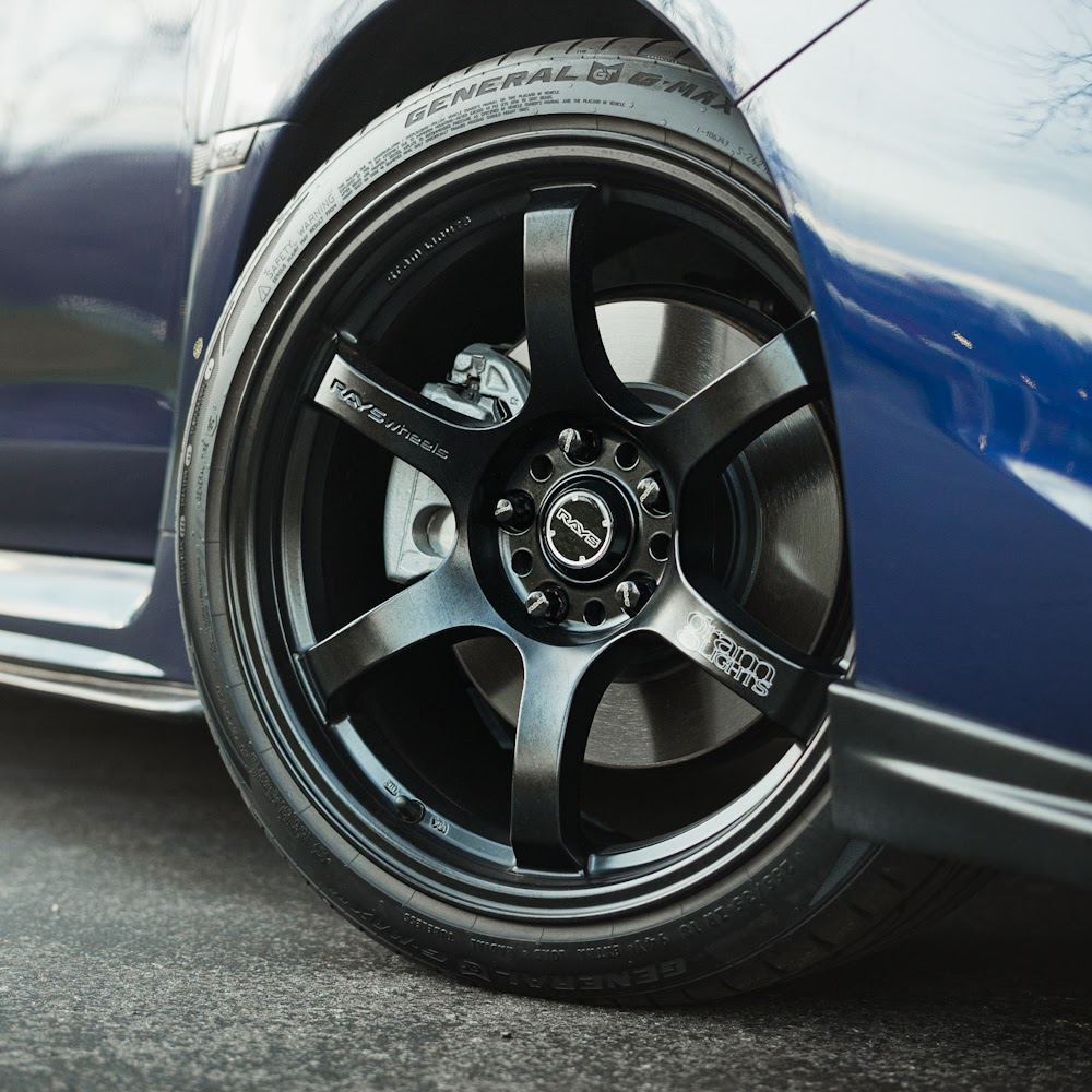 The painted calipers pop against dark wheels