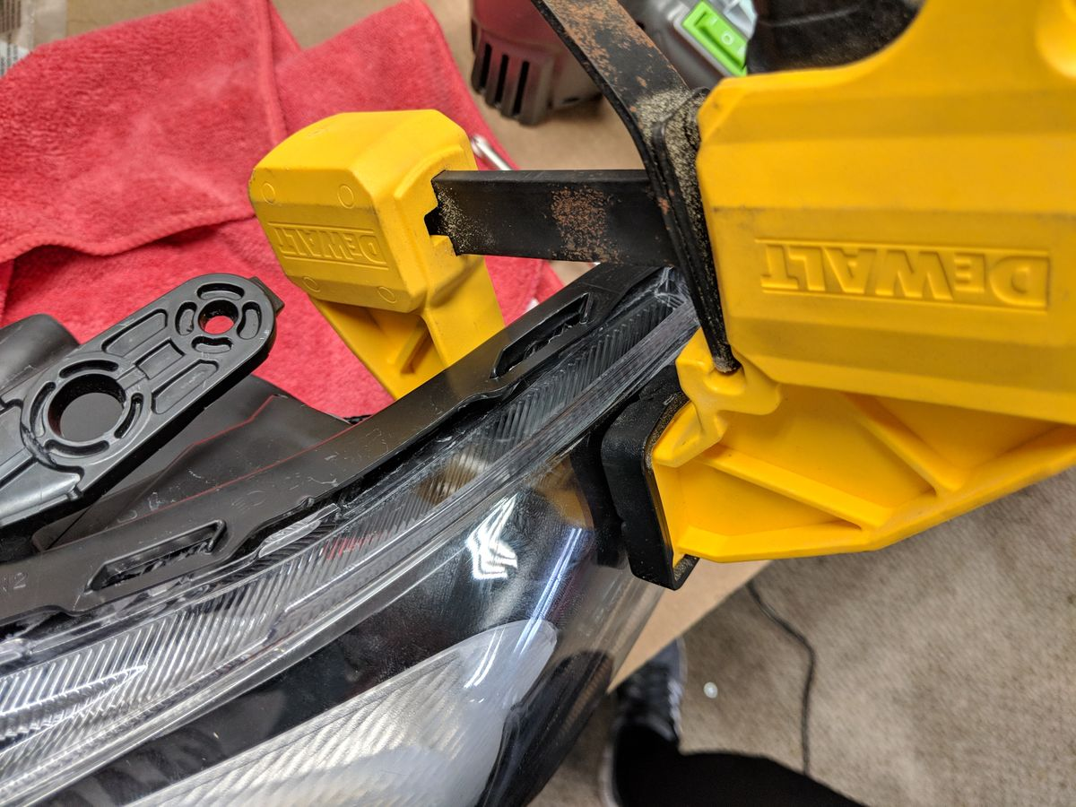 Using clamps can be helpful when reassembling the headlights