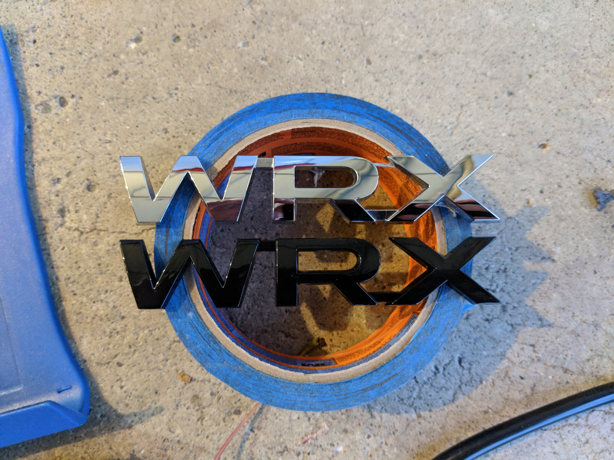 Replacement black WRX badge