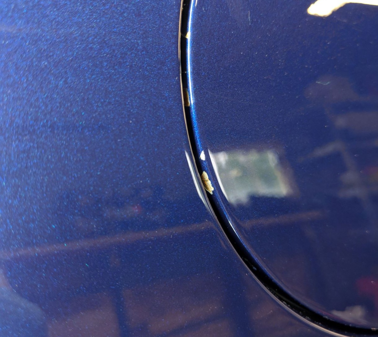 Gas cap paint chipping